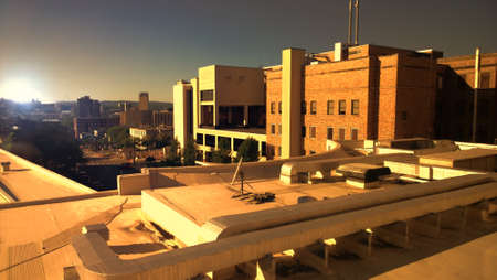 hospital building: rooftop view of buildings and city at sundown