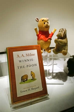 Rochester, New York, USA. October 24, 2015. The Strong National Museum of Play. Antique Winnie the Pooh book and stuffed animals