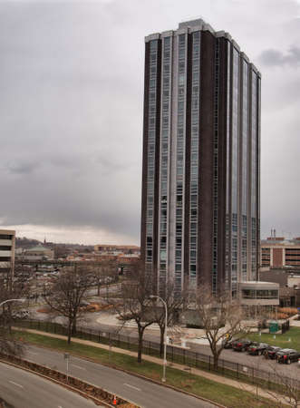 Syracuse, New York , USA. December 8, 2016. View of Madison towers, an apartment complexoverlooking interstate 81,  in Syracuse , New York on an overcast , late autumn, afternoon