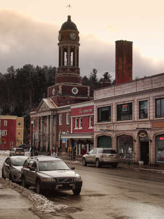Saranac Lake , New York, USA. January 19, 2017. The beautiful small village of Saranac Lake, New York located in the Adirondack State Park in wintertime, with the Saranac lake County Office Building in the background