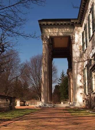 side view of the front entrance to a mansion