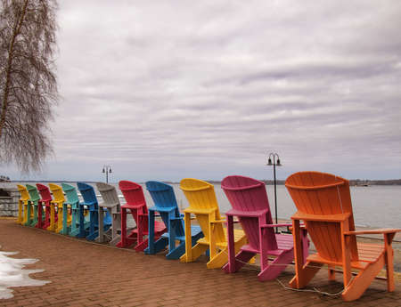 seaway: Adirondack chairs on the shore of The Saint Lawrence River facing The Thousand Islands in Clayton, New York