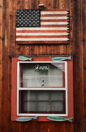 American flag on a boathouse Stock Photo