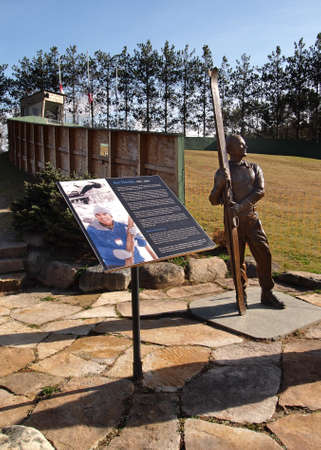 Lake Placid , New York, USA. October 10, 2017. Statue and memorial to Art Devlin , Olympic ski jumper who was born in the town of Lake Placid at The Lake Placid Olympic Ski Jumping Complex Editorial