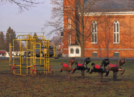 Old fashioned playground equipment in a small village park