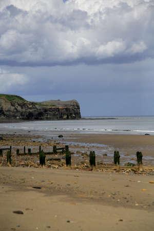 breakwaters: Breakwaters on Sandsend beach near Scarborough Stock Photo