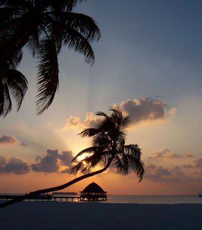 The sun setting Velavaru Maldives
