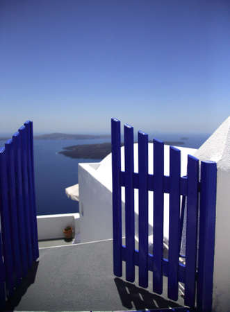 Blue gate leading you to the beautiful bay Santorini Greece Stock Photo