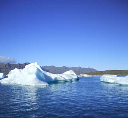 Icebergs on Jokulsarlon lagoon, Iceland against the mountains