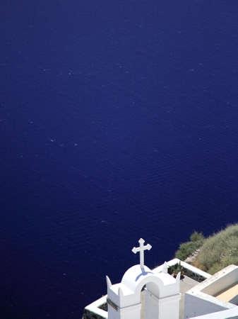 White church against the blue sea Santorini Greece photo