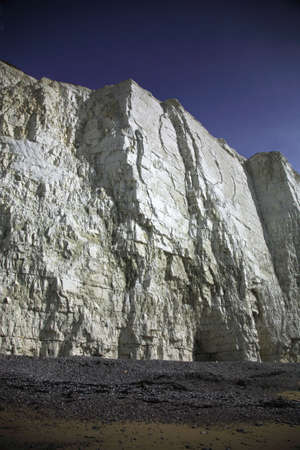 Towering white cliffs on the east coast of England photo
