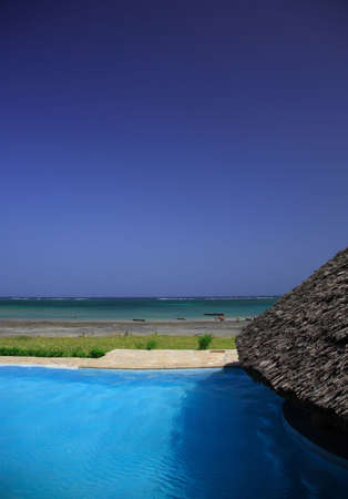 View from the pool across the beach Mombassa Kenay Africa photo
