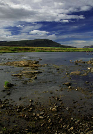 riverbed: View of the mountians across a shallow riverbed Iceland Stock Photo