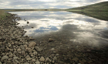 Reflection in the lake Iceland photo