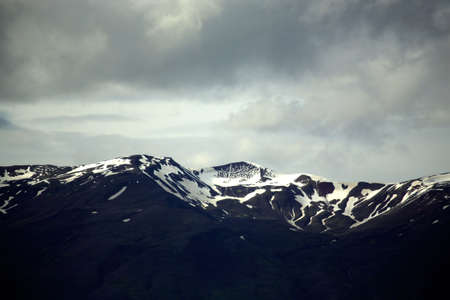 capped: Snow capped mountains in Iceland