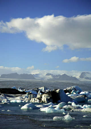 Icebergs with the glacier in the distance Jokulsarlon lagoon Iceland photo