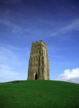 typically english: Glastonbury Tor against a vivid blue sky and green grass