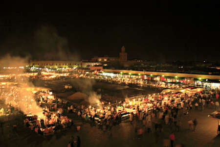 Bustling square in Marrakech Morocco at night photo