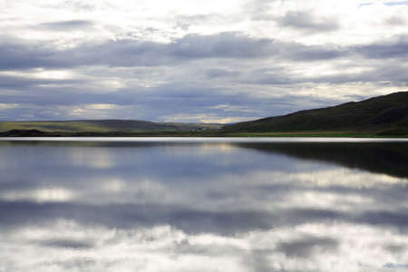 Tranquil lake at dusk in Iceland photo