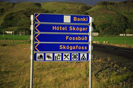 skogafoss waterfall: Signpost to Skogafoss waterfall, the bank and hotel Iceland