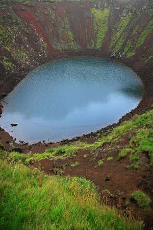 strikingly: Vivid aquamarine Kerid volcanic crater Iceland