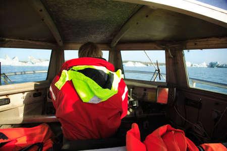 Boat driver on Jokulsarlon lagoon Iceland photo