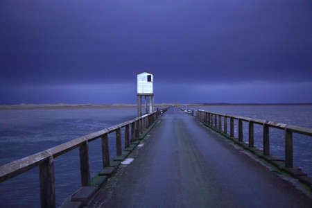 Lindisfarne Causeway against a dary stormy sky Northumberland photo