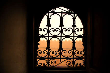 Decorative window in old Marrakech building Morocco photo