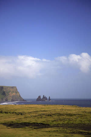 View to the volcanic sea stacks Iceland photo