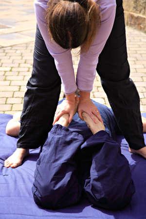 Quad stretch as part of a Thai body massage photo