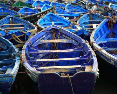 Moroccan blue fishing boats in Essaouira harbour Morocco