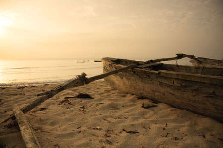 catamaran: Hand built catamaran on the beach at sunrise Mombasa Kenya