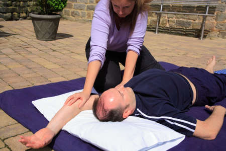 range of motion: Shoulder stretch as part of a Thai body massage