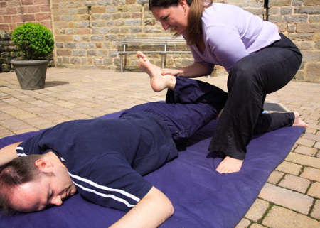 Mobilising the hips as part of a Thai body massage photo