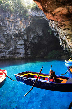 kefallonia: Worker in Melissani Cave, Kefalonia Greece Stock Photo