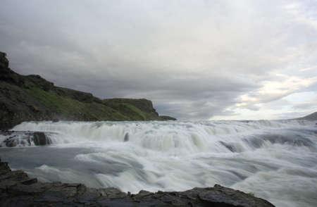 Thundering Gulfoss waterfall in Iceland photo