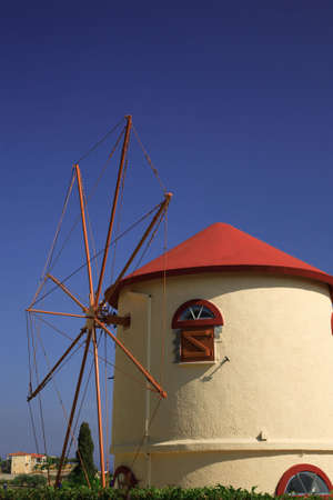 kefallonia: White windmill with a red roof against a blue sky in Kefalonia Greece Stock Photo