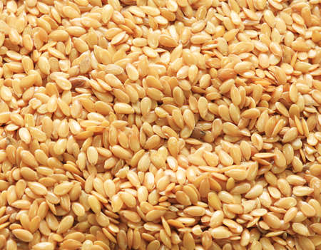 Close up of golden linseed also known as flax seed  photo