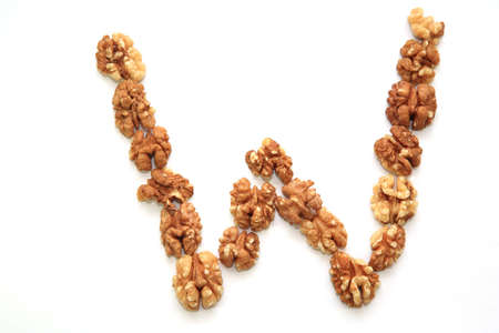 lowering: The letter W made up from walnuts Stock Photo
