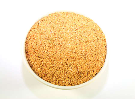 A bowl of golden linseed also known as flax seed photo