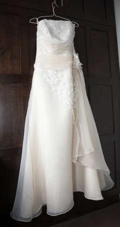 hangers: Wedding dress hung up on the wardrobe door Stock Photo
