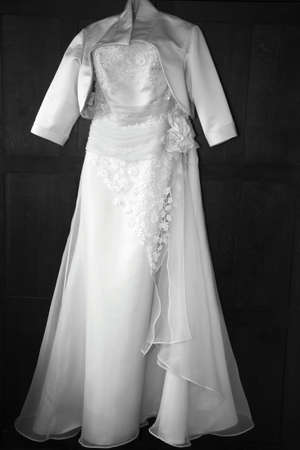 Black and white wedding dress hung up waiting for the bride photo