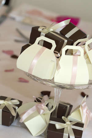 favours: Wedding favors in a glass bowl on the wedding table