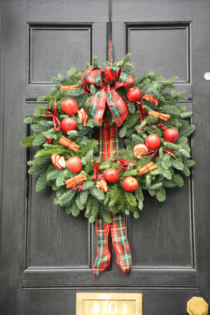 Red apple and chillies Christmas wreath Stock Photo