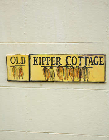 kipper: Old Kipper Cottage sign in Whitby North Yorkshire Stock Photo