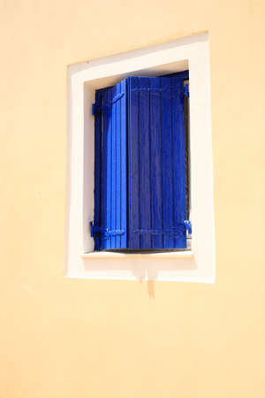 kefalonia: Blue window shutters in Kefalonia Greece Stock Photo
