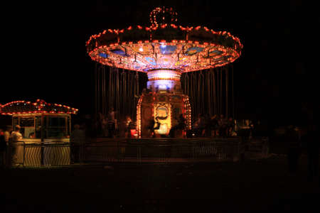 Stationary Merry Go Round at night in the UK  photo