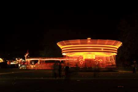Spinning merry go round at night in the UK photo
