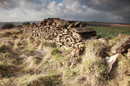 drystone: Sunlit dry stone wall North York Moors, England
