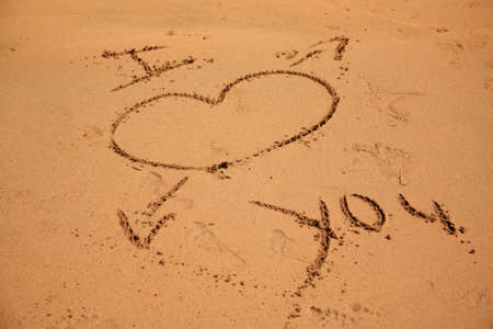 I love you written in the sand on the beach in Goa India Stock Photo - 8582641